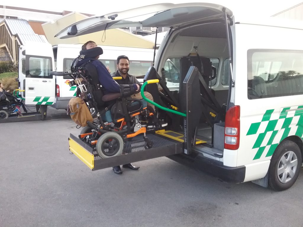 passenger being lifted into mobility van