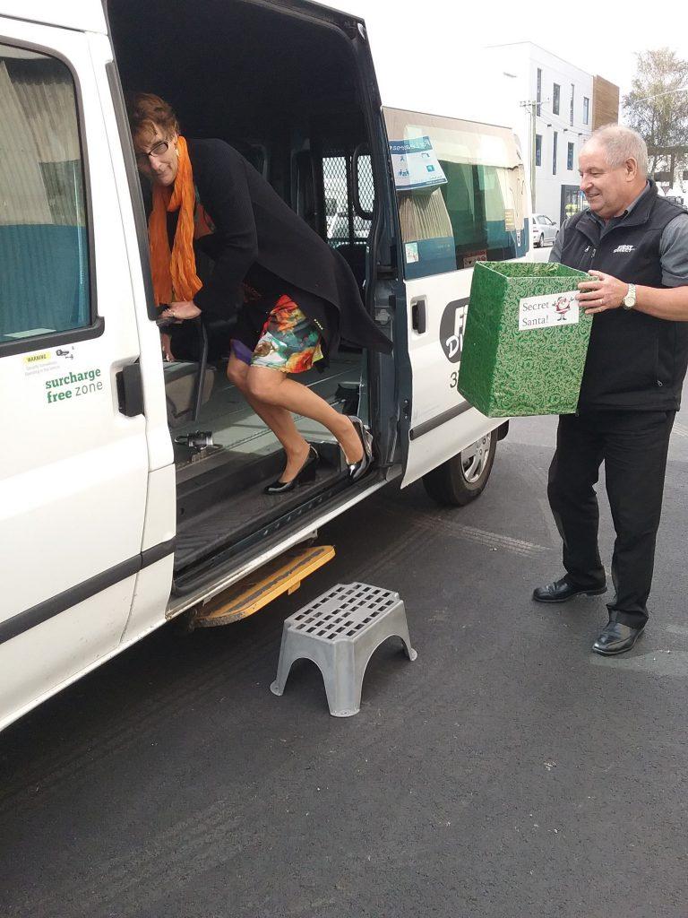 passenger getting into van